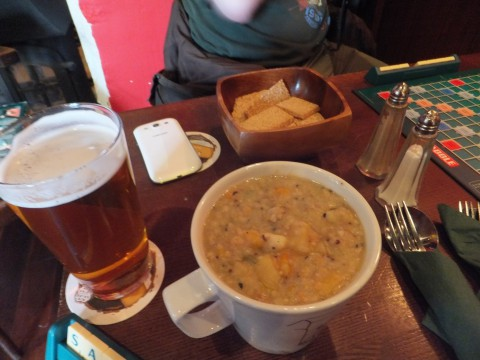 (Veggie) haggis stovie (in a mug), a bowl of oatcakes, and a pint of beer.