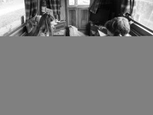 Ruth and JTA set up Arkham Horror in the narrowboat.